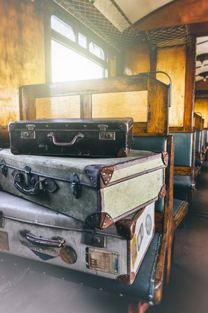 suit case: Retro travel cases in last century train coach. Passenger carriage