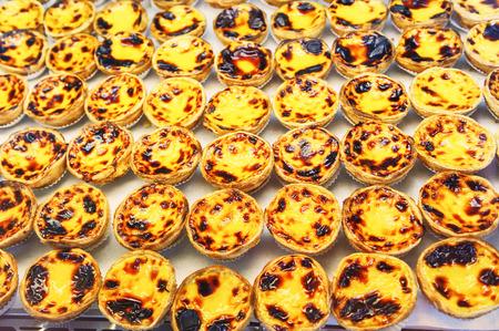 nata: Traditional portuguese pastry - pastel de nata in cafe showcase