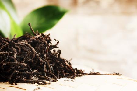 ceremony: Closeup of dry black tea. Health and diet concept