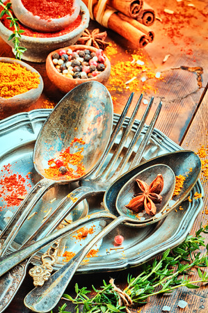vintage cutlery: Table setting with vintage cutlery and colorful mix of spices