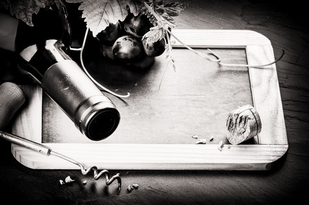 food and wine: Frame with wine bottle and fresh grape. Black and white Stock Photo
