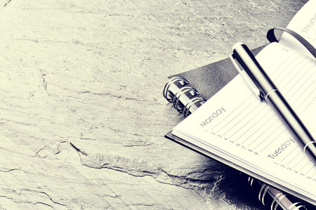 Business concept with paper agenda and pen. Copy space Archivio Fotografico