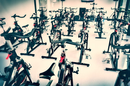 Healthy lifestyle concept. Spinning class with empty bikes