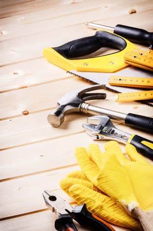 Set of various tools on wooden background. Construction concept Banque d'images