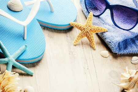 beach wear: Summer holiday setting with flip flops and beach wear. Copy space Stock Photo