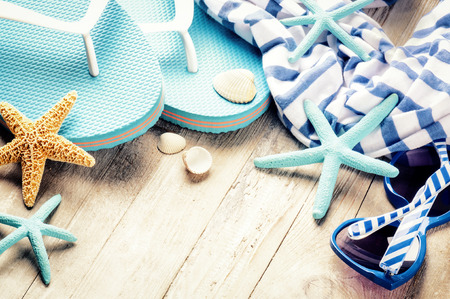 beachwear: Summer holiday setting with flip flops and beach wear. Copy space Stock Photo