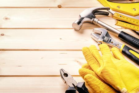 Set of various tools on wooden background.  Standard-Bild