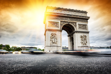 Beautiful sunset over Arc de Triomphe at Place de lEtoile, Paris