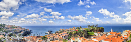 tropical beach panoramic: Panoramic landscape with view of Camara de Lobos, small fisherman village on Madeira island. Copy space