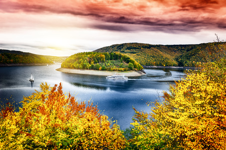 autumn landscape: Autumn landscape with spectacular sunset over river. Nature background Stock Photo