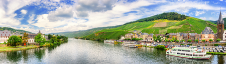 water panoramic: Panoramic landscape with vineyards surrounding the town of Bernkastel-Kues. Mosel, Germany. Autumn panorama Stock Photo