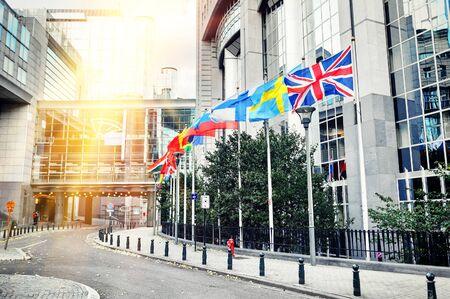 the european economic community: Waving flags in front of European Parliament building. Brussels, Belgium. EU background