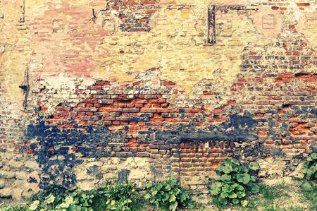 cracky: Old and cracky brick wall. Grunge background with copyspace Stock Photo
