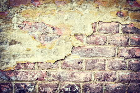 cracky: Old and cracky brick wall. Grunge background Stock Photo