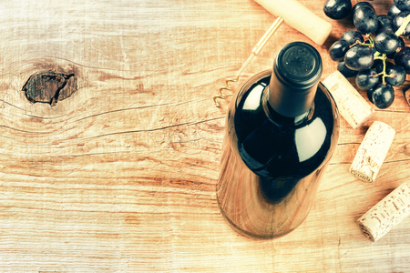 food and wine: Setting with bottle of red wine, grape and corks. Wine list concept with copy space Stock Photo