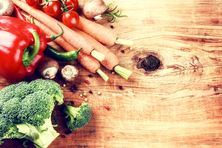 vegan: Cooking setting with fresh organic vegetables on old wood background. Healthy eating concept with copy space