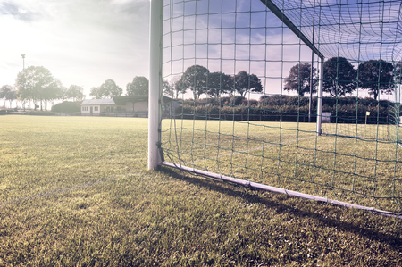 Soccer goal on summer field (football field)
