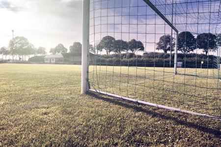 goal line: Soccer goal on summer field (football field)