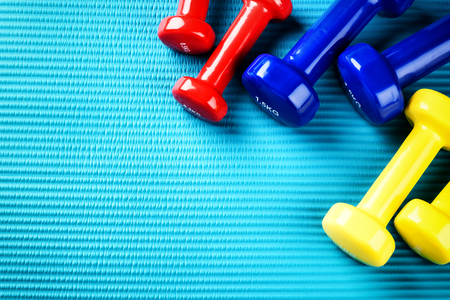 dumbbell: Fitness background with colorful dumbbells. Healthy lifestyle concept with copy space Stock Photo