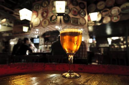 delirium: Glass of fresh beer. Delirium bar Brussels