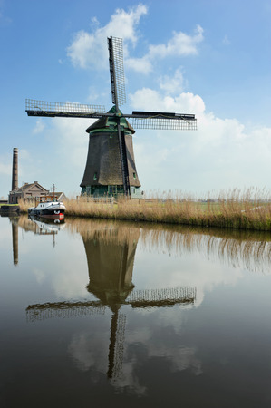 dutch windmill: A traditional dutch windmill near the canal. Netherlands Stock Photo