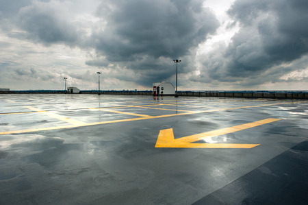 雨と空駐車場 写真素材