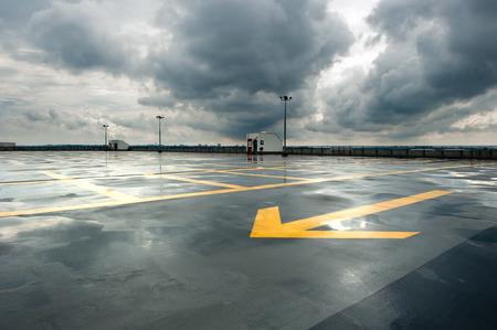 bad weather: Rainy and empty parking Stock Photo