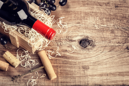 Setting with bottle of red wine, grape and corks. Wine list concept with copy space Stock Photo