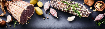 italian salami: Fine selection of dry meat and sausages. Gourmet dinner concept Stock Photo