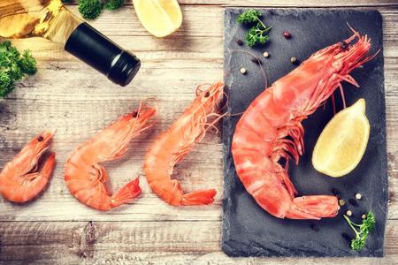 jumbo: Fine selection of jumbo shrimps for dinner on stone plate. Food background Stock Photo