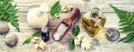 Spa setting with jasmine essential oil and flowers. Wellness concept, top view Stockfoto