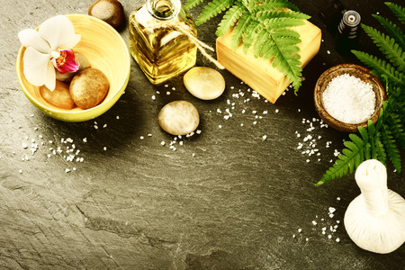 bathsalt: Spa setting with soap bar, herbal massage ball and essential oil. Wellness concept