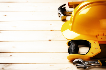Set of various tools on wooden background with copy space. Construction concept