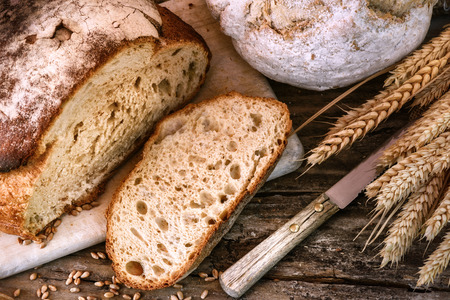 Freshly baked bread in rustic setting. Food background Stok Fotoğraf