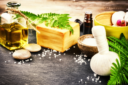 bathsalt: Spa setting with herbal massage ball, flowers and essential oil. Wellness and beauty concept