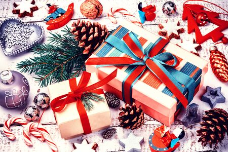 top of the year: Christmas holiday setting with presents in boxes and festive decorations. Christmas background, top view Stock Photo