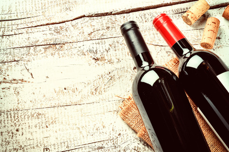 Setting with bottles of red wine and corks. Wine list concept with copy space Stok Fotoğraf - 66704196