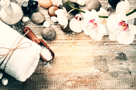 bathsalt: Spa setting with herbal massage ball and essential oil. Wellness and spa concept with copy space