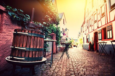 Narrow cobblestone street in old town at summertime. Cityscape Alsace, France Stock Photo