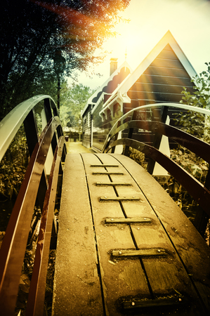traditional: Wooden bridge over canal in small Holland town. City travel background