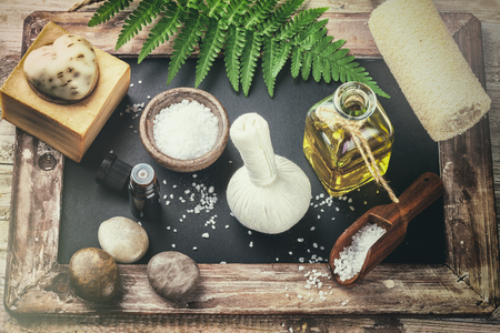 bathsalt: Spa setting with beauty treatment accessories - essential oil, herbal ball and soap bar. Wellness concept, top view Stock Photo