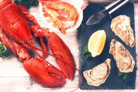 Steamed lobster, oysters and shrimps as fine selection of crustacean for dinner Stock Photo