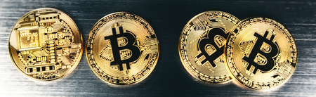 Gold bitcoins closeup. Virtual crypto currency and finance concept. Copyspace Stock Photo