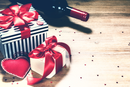 St Valentines background with presents and red wine bottle. Greeting card concept with copyspace