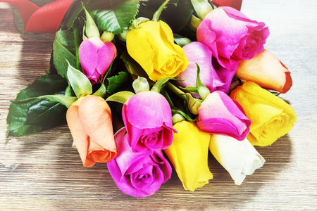 Bouquet of multicolor roses, closeup. St Valentines greeting card concept