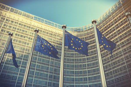 EU flags waving in front of European Commission building. Brussels, Belgium Stock Photo