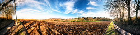 Panoramic agricultural landscape with ploughed field. Country nature background