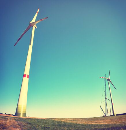 Landscape with construction site of wind turbines. Industrial concept with copyspace Stock Photo