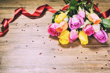 Bouquet of multicolor roses, closeup. St Valentines greeting card concept with copyspace