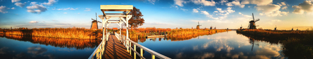 Landscape with traditional dutch windmills and bridge , Netherlands. Nature background